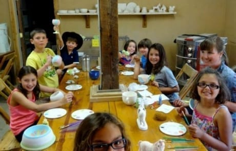kids at a craft table