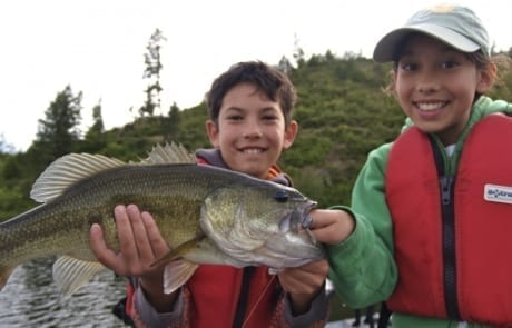 kids holding fish they caught