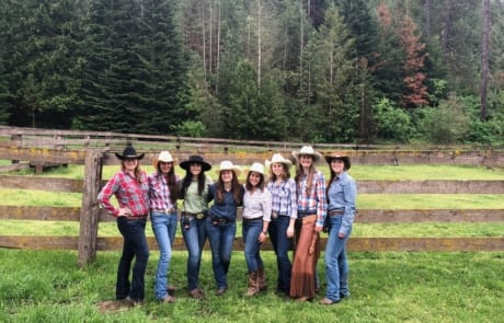Group of women posing at the ranch.