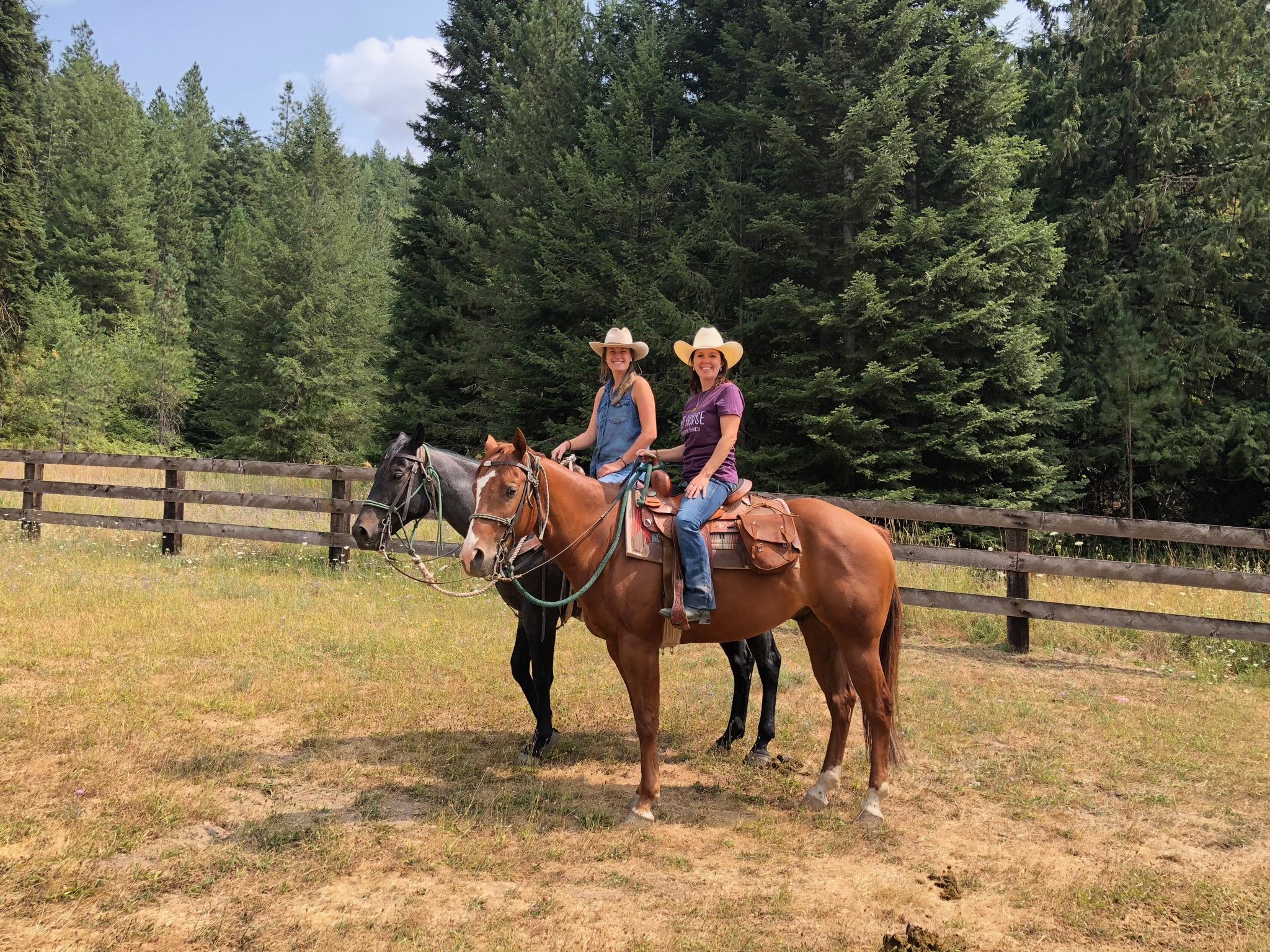 Two women on horseback.