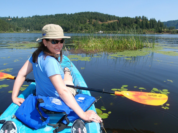 Woman in kayak on the lake.