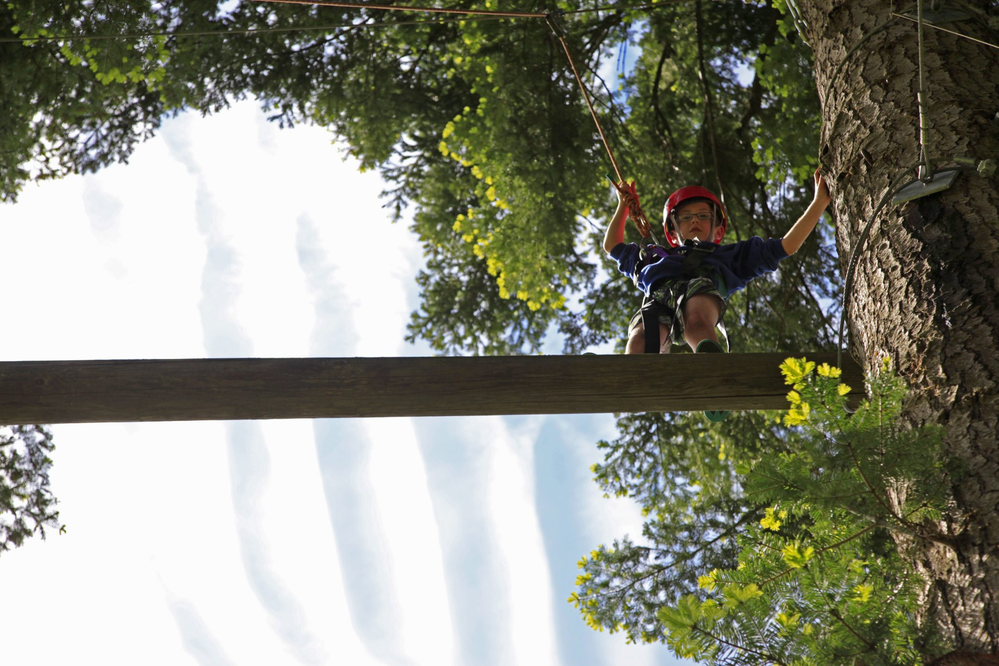 Young person on climbing challenge