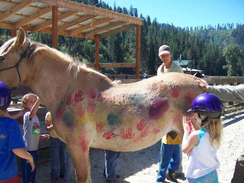 Young kids petting a horse.