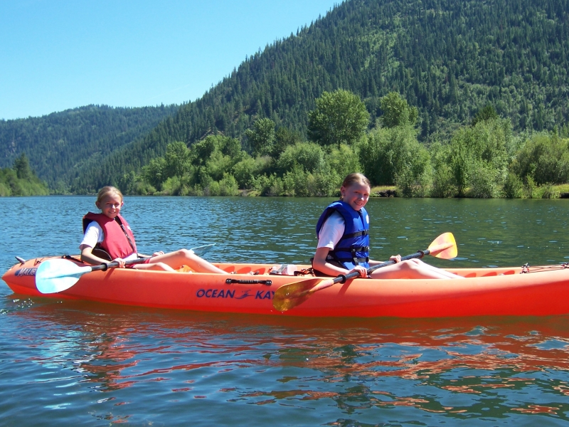 Two young people in a kayak.