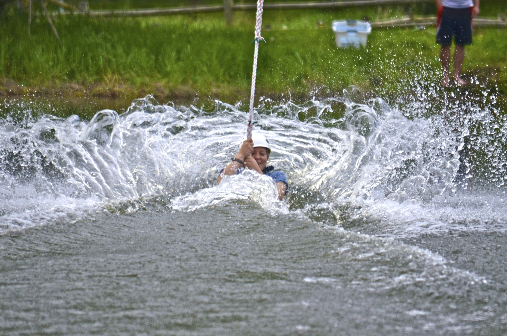 Person splashing into water from a zipline