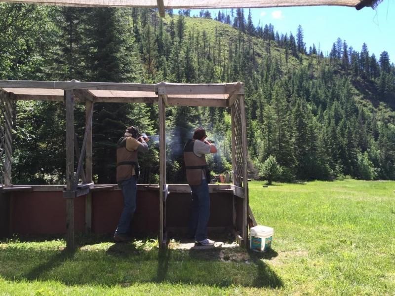 People clay target shooting