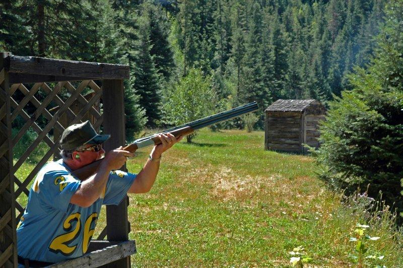 Man clay target shooting