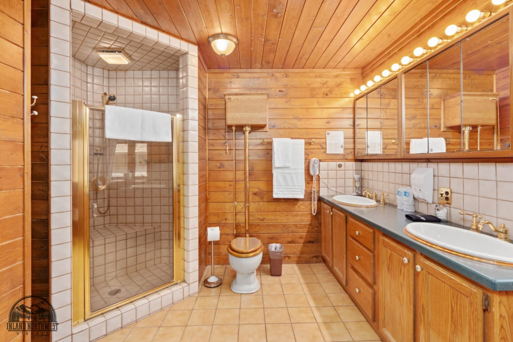 Hilltop Home bathroom with shower and twin vanity sinks.