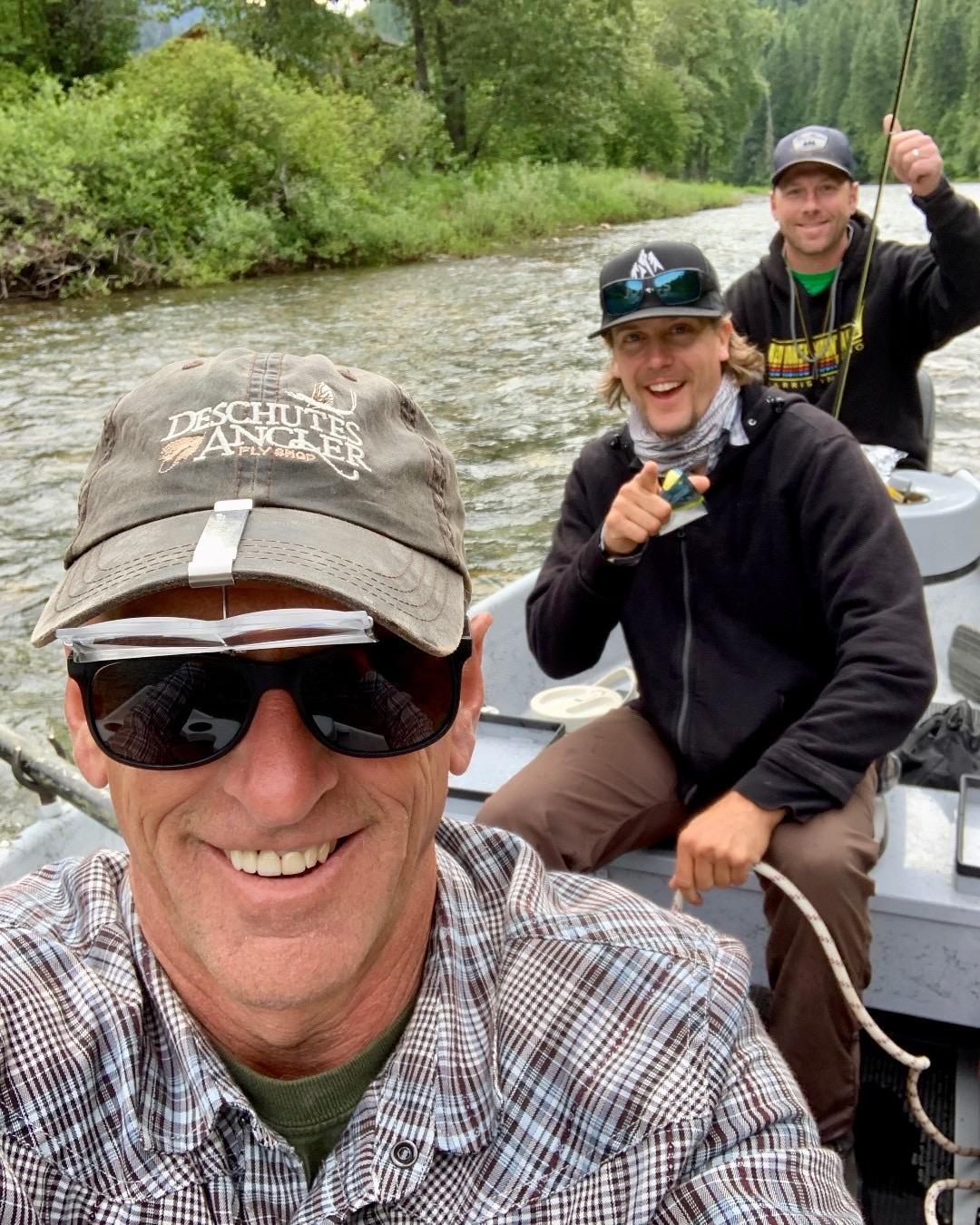 Men river fishing on a boat