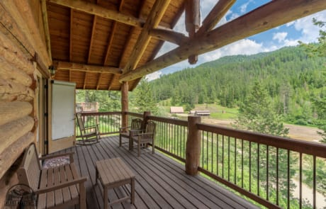 Monarch Cabin porch with view of ranch valley.