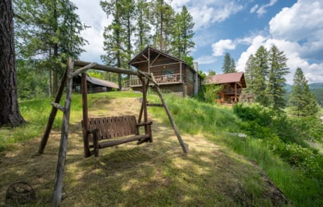 Wooden swing bench on hill.