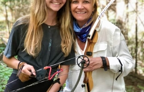 A mother-daughter couple getting ready to test their skills at the archery range.